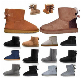 Pelliccia beige online-2020 Designer women uggs boots ugg winter boots travel luggage slippers kids ugglis australia australian satin boot ankle booties fur leather outdoors shoes