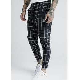 Pantalones de poliéster a cuadros online-2020 men's fashion new plaid sik silk printing casual sweatpants men's street hip hop fashion slim pants polyester Jogging pants 1120