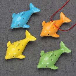 Delfino di ceramica online-Cute 6 Hole Ceramic Dolphin Ocarina Educational Toy Musical Instrument Animal Shape Educational Music Flute Charm FWF3889