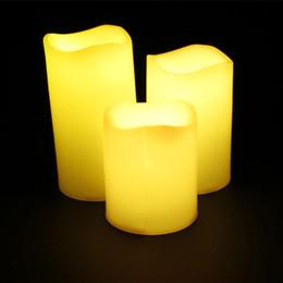 Batería led redonda online-Velas perfumadas de LED 3pcs 12 Cambio de color de cera real Borde redondo Sin llama Velas parpadeantes Funciona con batería con control remoto Tiempo