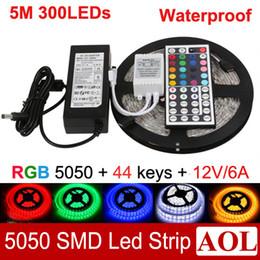 Wholesale Led Light Power Meter - 5050 SMD RGB 5m 300 LED Strip Light 60leds meter Waterproof IP65 + 44keys IR Remote + Power Supply (12V 6A) free shipping