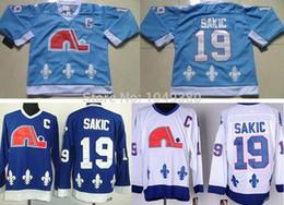 Argentina Camisetas de hockey sobre hielo de los hombres al por mayor Quebec Nordiques Sakic # 19 Joe Sakic azul marino de color blanco claro CCM Turn Back Old Style Stitched Jersey cheap quebec nordiques jersey sakic Suministro