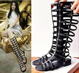 Argentina Moda sexy para mujer punta abierta talón plano hueco zapatos romanos Señora del gladiador de verano Botas romanas Vintage Sandalias negras Suministro
