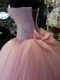 Argentina Imágenes reales Vestidos de quinceañera de color rosa con un gran lazo Corazón de abalorios Crystal Corset Encantador vestido de fiesta de fiesta 16 vestidos de gala para 15 años cheap big corsets Suministro
