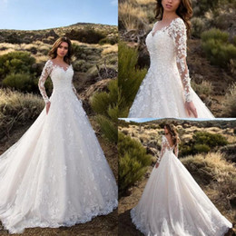 Wholesale sexy modest bridal gowns - Modest Long Sleeve Wedding Dresses With Pockets Lace Appliqued Backless Bridal Gowns Sheer Jewel Neck Garden Country Wedding Dress