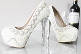 Argentina Impresionante marfil perlas zapatos de la boda Cristales Stiletto tacones altos plataforma de diamantes de imitación bombas zapatos de novia punta redonda envío gratis WS1 cheap ivory rhinestone wedding shoes Suministro