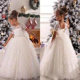 Wholesale Tulle Fluffy Flower Girl Dresses - 2018 White Christmas Flower Girls Dresses Capped Lace Ball Gown for Wedding Bow Sash Fluffy Custom Made Girls Pageant Dresses BO9378