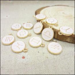 Canada En gros 36pcs / lot émail alliage plaqué or bijoux Mixte Zodiac charmes pour bracelet collier DIY fabrication de bijoux Offre