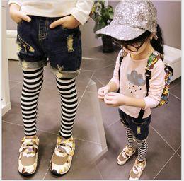 Wholesale Kids Leggings Jeans - Girls Clothes Stitching Jeans 2018 New Kids Hole Jeans False Two Piece Stripe Trousers Child Clothing Children Long Leggings Cowboy Pants