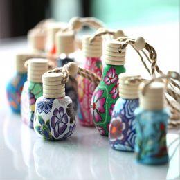 Wholesale Fashion Craft Supplies - Retail 5pcs lot Fashion 15 ML Car Hang Ornament Clay Perfume Bottle Ceramic Essence Oil Empty Bottle Craft Supplies Free Shipping