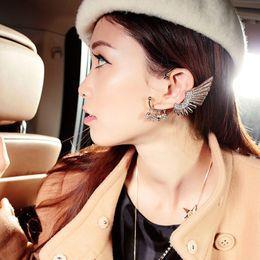 Wholesale Earrings Lo - Global low-cost 2015 Europe exaggerated angel wings skull non pierced ears hanging Tassel Earrings wholesale female single [price] 12pair lo