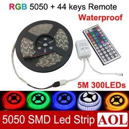 Wholesale Free Remote Pc - 5m lot LED Strips 5050 SMD RGB 300 LED light ribbon Waterproof IP65 with free 44keys IR Remote free shipping