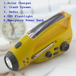Wholesale Solar Dynamo Charger Flashlight - multifunction crank Dynamo solar power radio FM AM with LED flashlight, Emergency power bank for mobile charger free shipping