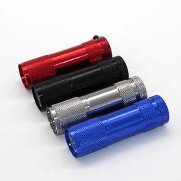 Discount small white led battery - wholesale 9LED 9 LED mini torch white light ED Flashlight 3x AAA battery small torch flashlight Free DHL
