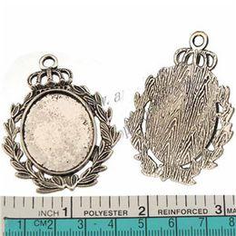 Cavidade de vidro oval on-line-cabochão de vidro photo cameo encantos pingentes diy bangles colares oval coroa oco tibetano prata metal 53mm jóias descobertas 30 pcs