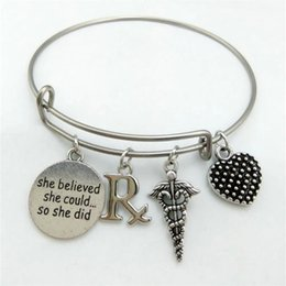 Wholesale Coppers Symbol - Wholesale- my shape Pharmacy Symbol RX & She believed she could...so she did Word Charm Stainless Steel Expandable Wire Bangle DIY Medical