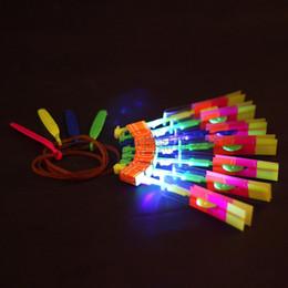Wholesale Cheap Led Light Up Toys - Wholesale- 1 Pieces LED Flying Arrow Helicopter Flying LED Umbrella Toys LED Light Up Toy Rocket Slingshot Toys Cheap Toys