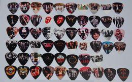 Wholesale Guitars Floyd - Wholesale 58pcs lot Medium Various Guitar Picks Rock Bands GNR Rolling Stones 1D Pink Floyd
