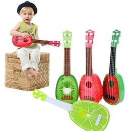 Wholesale Guitar Kid - Wholesale-4pcs lot Cute Toy Guitar Fruit Pattern 4 String Musical Ukulele Instrument Educational Toy For Kid Gift