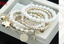 Wholesale Pearl Bangles Designs - 2015 Hot Spring Bracelet Korean Design Fashion Bohemia Beads Bracelet Peal Star Towl Beaded Multilayer Bracelets Bangles For Women Girl 9982