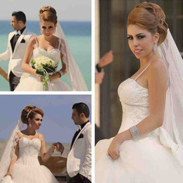 Wholesale Sweetheart Corset Top Wedding Dress - Gorgeous African Arabic Ball Gown Wedding Dress Sweetheart Spaghetti Straps Crystals Beading Top Corset Back Lace Applique Bridal Gown Bow