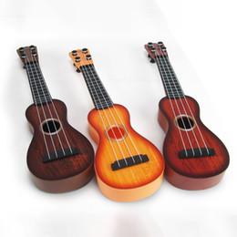 Wholesale Wholesale Ukulele - Wholesale Simulation Musical Instrument Toys 4 Strings Ukulele Mini Learning Educational Toy Ukulele For Beginners Kids Random Color
