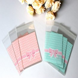 Wholesale Cake Bag Design - Wholesale- Fashion 100pcs bag OPP Plastic package bag Lovely Pink or Blue Bow Design Cake gift Packages Candy Pack paper