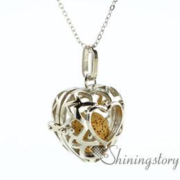 Wholesale Silver Aroma Pendant - heart openwork essential oil diffuser necklace diffuser pendants wholesale make your own oil diffuser aroma necklace lava volcanic stone met