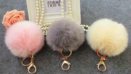 2019 ornamentos de bolsa por atacado 10 cores Adorável bola de pêlo saco de acessórios Chaves Enforcamentos Acessórios Fuzzy Bola keychain chave Do Carro saco de bola de coelho enfeites de cabelo grande raposa de Pelúcia
