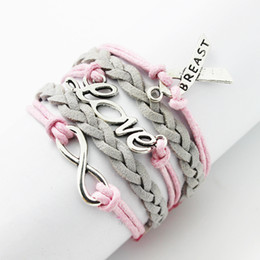 2017 ruban rose Bracelet Ruban de cancer du gros-Multilayer amitié cuir Rope main rose cire coton cordon Imitation sein de velours de cuir ruban rose promotion