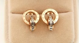 Wholesale gold studded earrings - New Korean version of the ultra-flash diamond square Roman double-headed studded fashion ladies titanium steel wild earrings jewelry