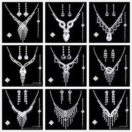 Wholesale Silver Earings Free Shipping - Crystal Bridal Jewelry Wedding Accessories Sets 4 Pieces Free Shipping Silver In Stock Rhinestone Wedding Dress Necklace Earings 2017