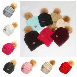Wholesale Faux Knitting - CC Pom Pom Skullies Beanies Women Winter Cap Faux Fur Pompom Beanie Knitted Hats 17 Colors OOA3385