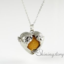 Wholesale wing heart necklace red - openwork wings volcanic stone wholesale diffuser necklace essential oil jewelry essential oil diffuser locket aromatherapy inhaler