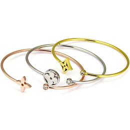 manchette large en argent sterling Promotion Titane en acier à quatre feuilles fleur manchette Bracelet bracelets en or pour les femmes punk classique bracelet Pulseiras ouvrir bracelet marque de bijoux de mode