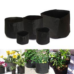 Contenedores de pe online-Recipiente redondo Maceta Creativa Las telas no tejidas crecen bolsas para prácticas de jardinería Suministros Negro 55sj C R