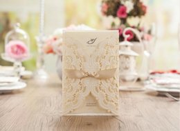 Wholesale Embossed Wedding Invitations Ribbon - Ivory Laser Cut Wedding Invitations Convite Casamento Wedding Supplies Elegant Embossed Invitation Card with Ribbon Printable