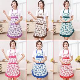 Nuevo delantal impreso con bolsillos Impermeable babero floral cocina con suelo libera Bowknot Textiles para el hogar pañuelo desde fabricantes