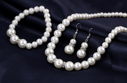 Wholesale Wholesale Nigerian Jewelry - 2015 Cream Faux Pearl and Disco Rhinestone necklace earrings Bracelet set nigerian wedding beads jewelry wedding necklaces pearl set
