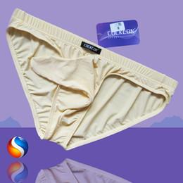Wholesale Sexy Novelty Underwear - New Men's Sexy Underwear The Bullet Gun Egg Separation U Convex Sexy Man Transparent Underwear JJ Set of Silk Elephant Briefs