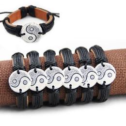 Argentina Comercio al por mayor 12 unids HandmadeTaoist Tai Chi Yin Yang pulseras de cuero de surf brazalete de regalo Suministro