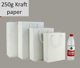 Wholesale White Kraft Paper Shopping Bags - Freeshipping Big Paper Shopping bag 250g Pure Wood Pulp Kraft Paper Bag White Thick Paper Gift Bag Gift Box for Shops Stores Shopping Center