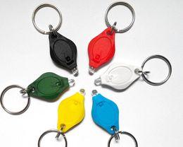 Wholesale Colored Led Keychain - Free shipping 500pcs lot mini led keychain Light colored LED Bulb Thumb Colorful Light Keychain Flashlight
