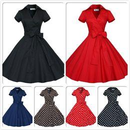 beiläufige weinleseart Rabatt Audrey Hepburn Vintage Style Casual Kleider Moderne Rüschen Frauen Europäische Kurzarm mit Schleife Band Revers Hals Röcke OXL127