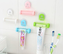 Wholesale Tooth Holder Squeezer - Shot-in Creative Rolling Squeezer Toothpaste Dispenser Tube Partner Sucker Hanging Holder tooth paste Tube squeezer Free shipping