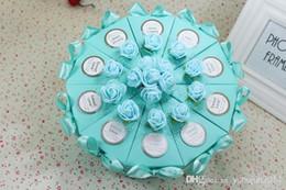 Deutschland 2015 Kuchen-Form-Papier-Süßigkeit-Kästen mit Blumen-Bowknot-Band für romantische Hochzeits-Bevorzugungs-Partei-Geschenkbox-Halter-freies Verschiffen Versorgung