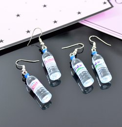 Wholesale Three Heart Dangle Earrings - Personality Water bottles earrings fashion in Europe and the nightclub perfume bottles stud earrings three colors