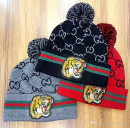 Wholesale Girls New Arrivals - New Arrival men Spring Winter beanies brand fashion classic Embroidered tiger knitted hat women stripe warm Unisex skull caps