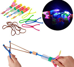 Wholesale led helicopter slingshot - 200pcs lot Free UPS Fedex Ship Slingshot Led Light Arrow Rocket Helicopter Flying Toy Party Fun Gift Elastic (The LED Slingshot Helicopter)