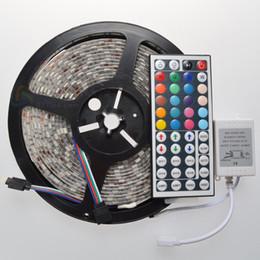 Wholesale Free Remote Pc - 5m lot LED Strips 5050 SMD RGB 300 LED light ribbon Waterproof IP65 with free 44keys IR Remote LED Strips Lights